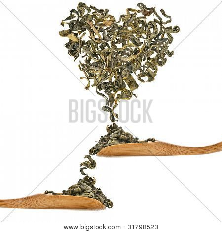 Green Tea heart of the fall of a spoons on a white background