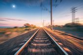 Railroad And Beautiful Blue Sky With Full Moon At Sunset With Motion Blur Effect In Summer. Industri poster