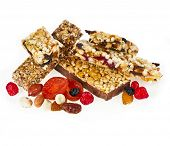 Granola bar with dried fruit and nuts on white background