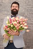 Romantic Man With Flowers. Romantic Gift. Macho Getting Ready Romantic Date. Tulips For Sweetheart.  poster