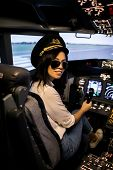 Female Pilot In The Airplane Cockpit. Pilot Wearing Sun Glasses And Hat poster