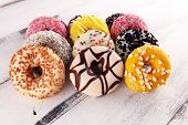 Assorted Donuts With Chocolate Frosted, Pink Glazed And Sprinkles Donuts poster