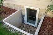 Exterior View Of An Egress Window In A Basement Bedroom. These Windows Are Required As Part Of The U poster