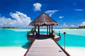 stock photo of pacific islands  - Jetty with amazing ocean view on tropical island - JPG