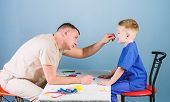 Man Doctor Sit Table Medical Tools Examining Little Boy Patient. Health Care. Pediatrician Concept.  poster
