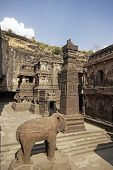 foto of ellora  - Stone elephant and obelisk outside the ancient Hindu Temple  - JPG