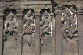 stock photo of ellora  - Stone carved statues on the front of the Kailas Hindu Temple at Ellora Caves near Aurangabad India - JPG