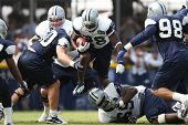 OXNARD, CA. - AUG 15: Dallas Cowboys RB (#28) Felix Jones breaks tackles during the second day of th