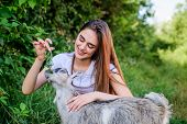 Woman And Small Goat Green Grass. Veterinarian Occupation. Eco Farm. Love And Care. Animals Law. Far poster