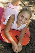 stock photo of boogie board  - Girl Lying on Boogie Boards - JPG