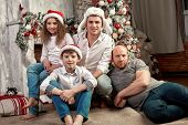 Christmas Family. Happiness. Portrait Of Dad, Mom And Children Of Different Ages Are Sitting On The  poster