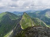 View From Ostry Rohac Peak On Western Tatra Mountains Or Rohace Panorama. Sharp Green Mountain Peak  poster