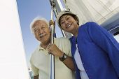 stock photo of early 60s  - Smiling Couple on Sailboat - JPG