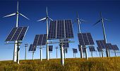 stock photo of wind-turbine  - Of wind generators and solar panels on the sky - JPG