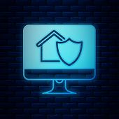 Glowing Neon Computer Monitor With House Under Protection Icon Isolated On Brick Wall Background. Pr poster