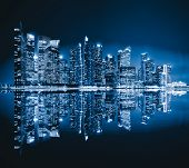 Singapore Downtown Skyline At Night With Reflection. Financial District And Business Centers In Tech poster