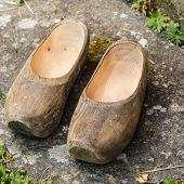 Regional Tradition And Culture, Handmade Concept. Closeup Of Wooden Dutch Shoes, Traditional Clogs F poster