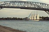 Bluewater Bridge With Tall Ship In Sarnia Ontario Canada poster