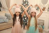Winter Season Accessory. Children Wear Knitted Hats. Girls Long Hair Happy Smiling Faces Christmas T poster