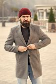 Buttoning His Jacket. Hipster Outfit And Hat Accessory. Stylish Casual Outfit Spring Season. Menswea poster