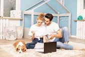 Young Couple In Childrens Room. poster