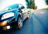 stock photo of speeding car  - Fast car moving with motion blur - JPG