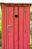 Wooden Public Toilet Door With Heart Hole Outdoor On Rest Place In Nature, Wc Restroom. Old Traditio poster