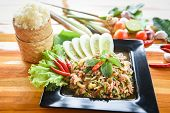 Spicy Minced Pork Salad Thai Food Served On Table With Herbs And Spices Ingredients Sticky Rice Trad poster