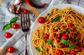 Italian Spaghetti With Tomato Sauce. Cherry Tomatoes And Basil On A White Dish On A Linen Tablecloth poster