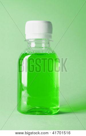 Plastic Bottle Of Green Mouthwash On White Background