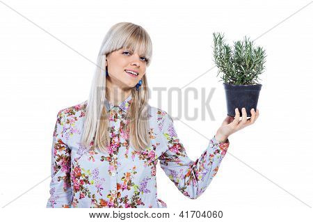 Beautiful Girl With A Rosemary Plant
