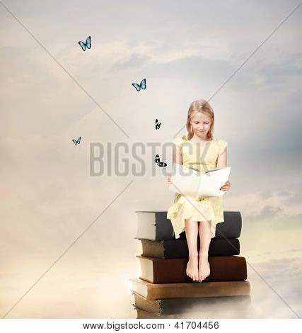 Little Blonde Girl Reading A Book