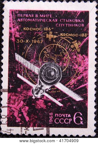 RUSSIA - CIRCA 1968: stamp printed by USSR shows first automatic joining two satellites in space