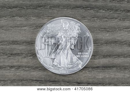 Pure Silver Dollar On Faded Wood
