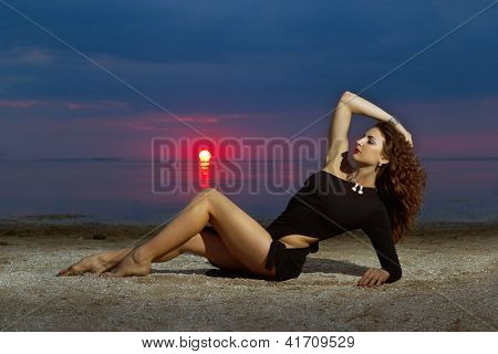 Woman Lying On The Shore