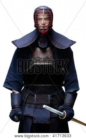 Portrait of equipped kendo fighter with shinai, isolated on white. Japanese martial art of sword fighting