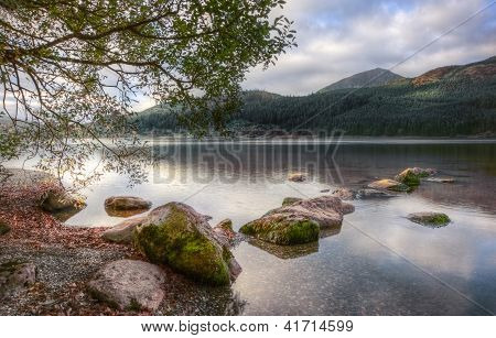Landscape Over Llyn Cwellyn In Snowdonia National Park Towards Mountains In Distance