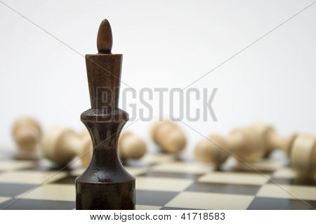 Black Chess King Against White Pieces