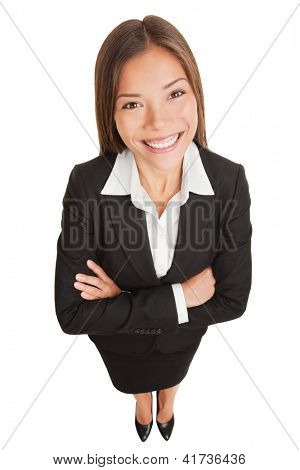 Business woman. Asian businesswoman portrait of smiling young professional in suit. High angle view of proud confident mixed race Asian Chinese / Caucasian isolated in full length on white background