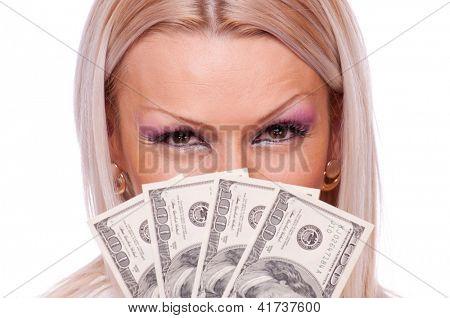 Close up shot of a blonde holding a fan of hundred-dollar bills