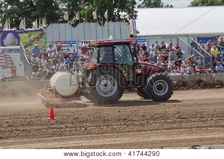 Case Tractor Watering The Track