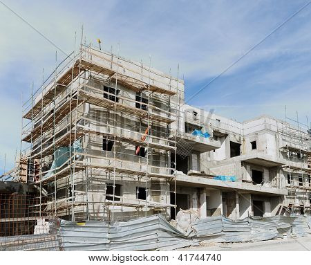 Three-storeyed apartment building under construction