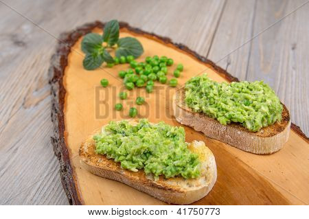 Delicious Crostini With Puree Of Raw Beans And Peas