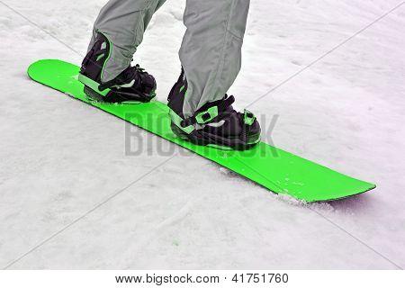 Sportsman With Green Snowboard On White Snow, Seasonal Sport
