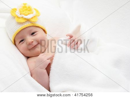 Smiling Baby Lies In Bed