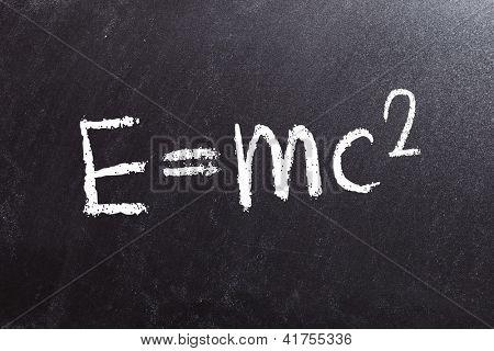 the theory of relativity formula, written on a blackboard