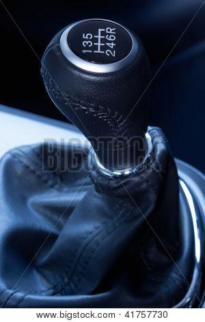 Close-up of a  six speed manual gear stick.