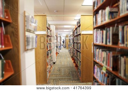 a view of an aisle in a public library