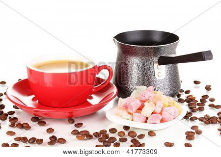 Red cup of coffee with rahat delight (locum) and coffee pot isolated on white