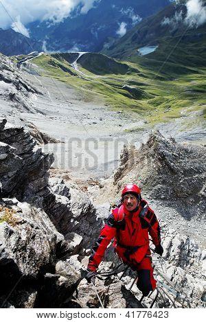 Alpinist climbing Eiger Peak, Berner Oberland, Switzerland - UNESCO Heritage